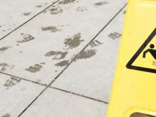 accident in a public place article depicted by Swain & Co with image of a wet floor sign in communal area