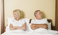 divorce rate article depicted on Swain & Co website as couple in bed not talking